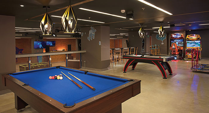 Games room with pool table and arcade games