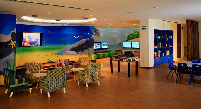 Indoor dining area with walls decorated in under sea prints