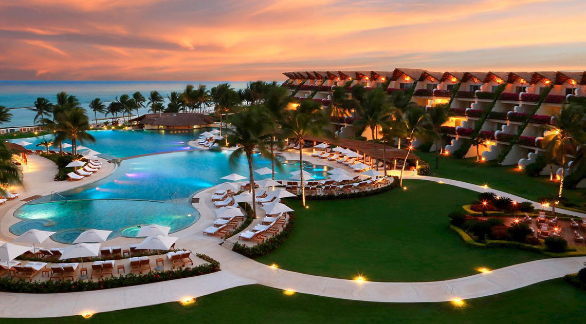 Sunset view of resort, pool and sea at Grand Velas Riviera Maya