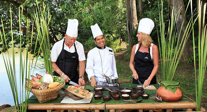 Chef teaching guests how to cook outside