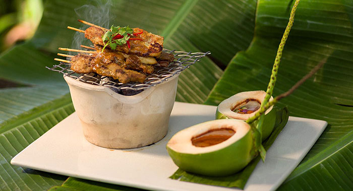 Fresh coconut and cooked skewers