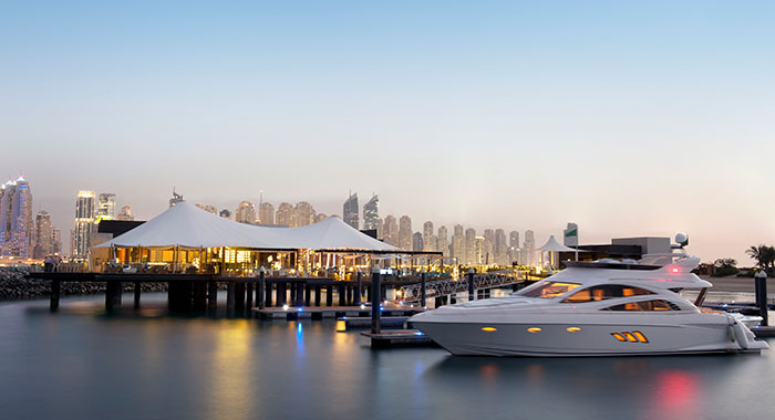 Overwater bar with Dubai skyline in background