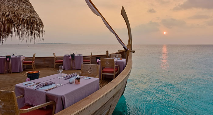 outdoor restaurant shaped like a boat over the sea