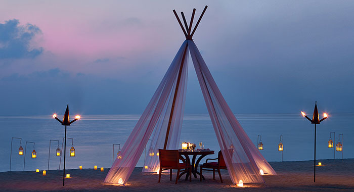 Romantic tipee and lanterns on the beach for a romantic intimate meal