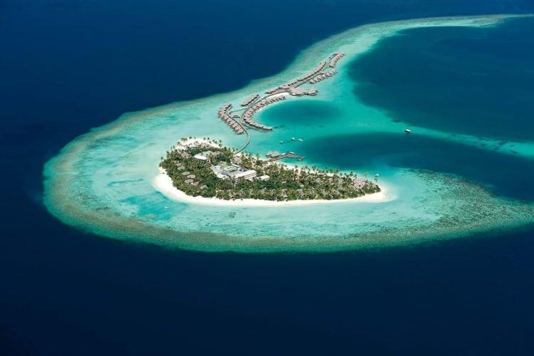 Aerial of island and villas