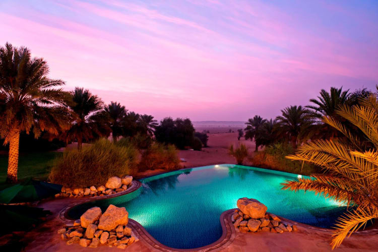 Pool and desert at dusk