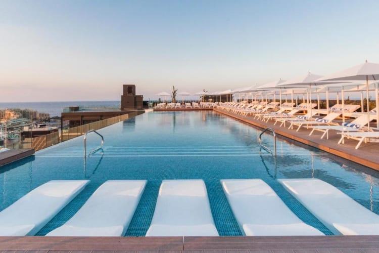 Sunbeds in pool