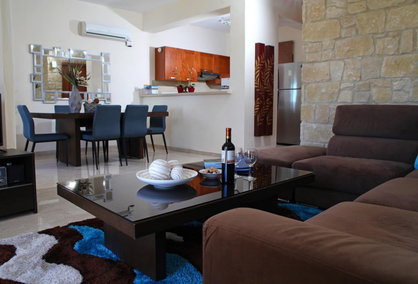 Junior Villa with Communal Pool living dining