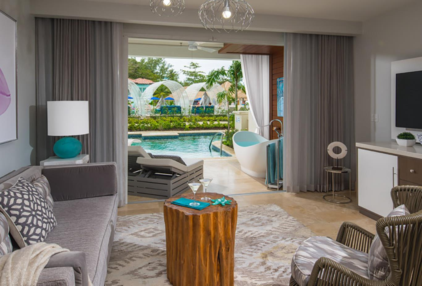 1SUP Royal Seaside Crystal Lagoon Swim Up One Bedroom Butler Suite with Balcony Tranquillity Soaking Tub living room
