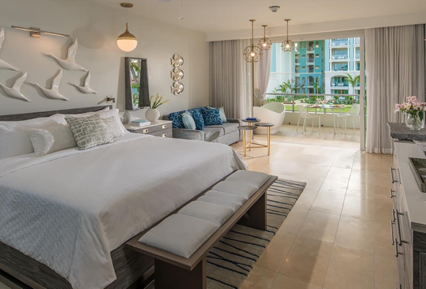 OSLB Royal Seaside Oceanview Crystal Lagoon Club Level Barbados Suite with Balcony Tranquillity Soaking Tub bedroom