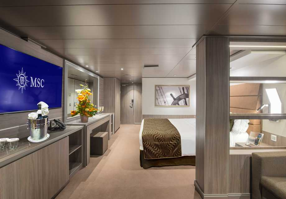 MSC Yacht Club Deluxe Suite bed and sitting2
