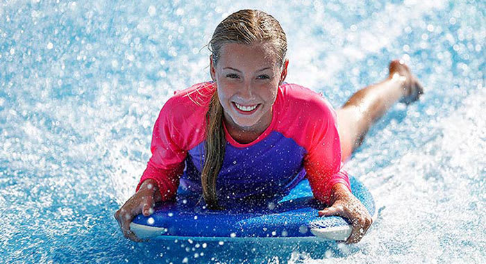 Woman on paddleboard smiling