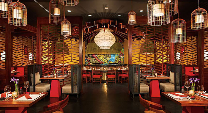 Asian style restaurant with lanterns and red furnishings