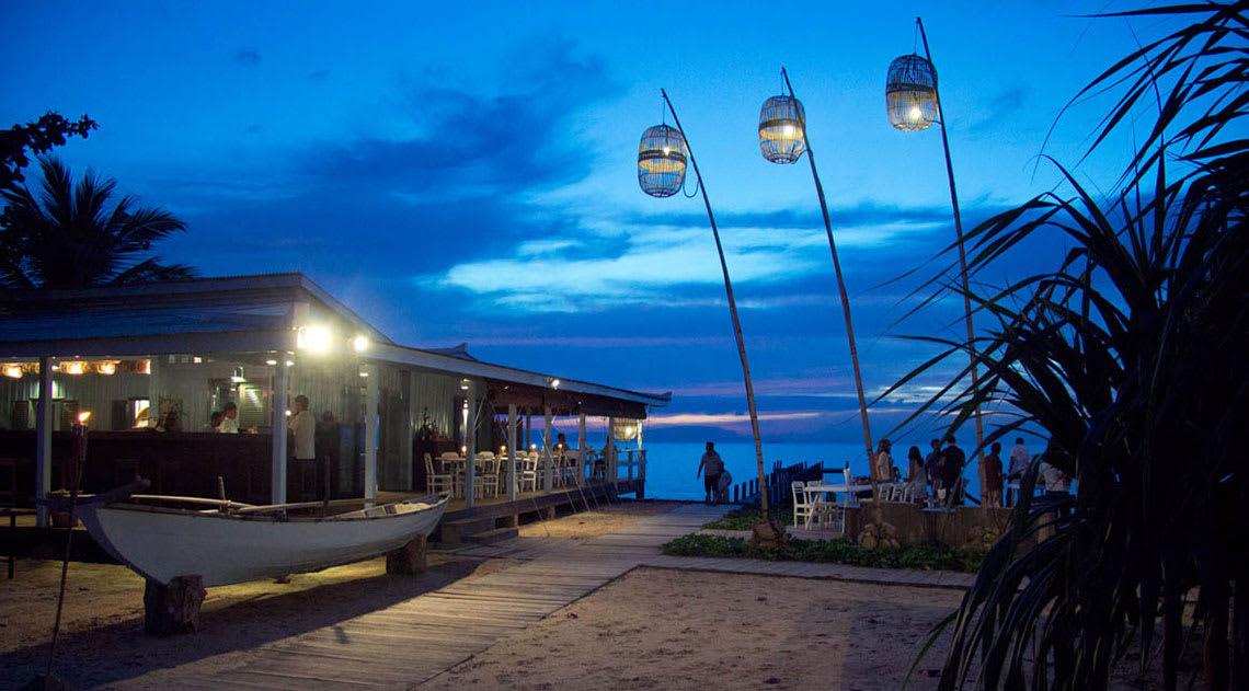 Knai Bang Chatt restaurant by the beach in the dark