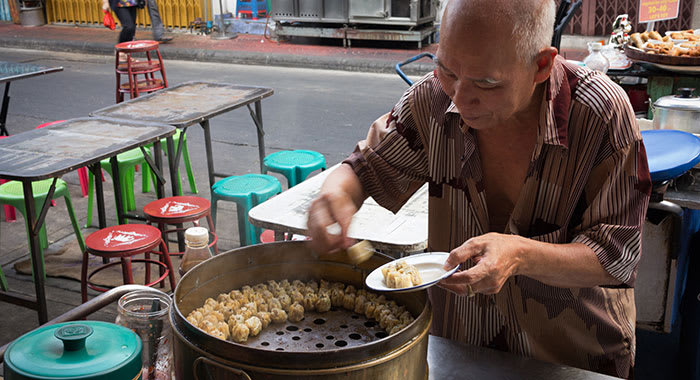 Man eating meal in Chinatown