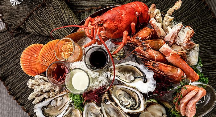 Platter of seafood inclduing whole lobster and prawns