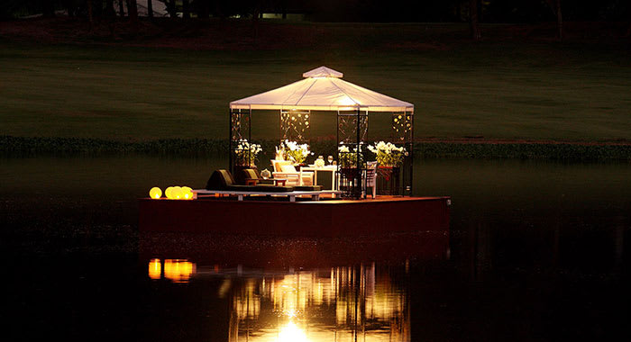 Floating table for two at night time