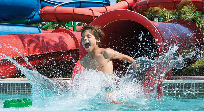 Waterslide with child splashing out of it