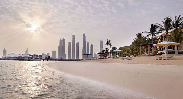 Private beach with skyline in the background