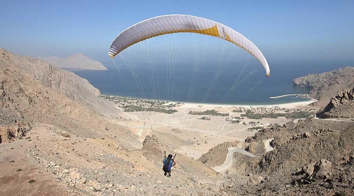 Paragliding arrival at Six Senses Zighy Bay