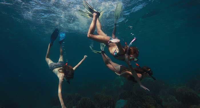 Kids snorkeling at Six Senses Zighy Bay