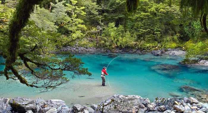 Gentleman fishing in river