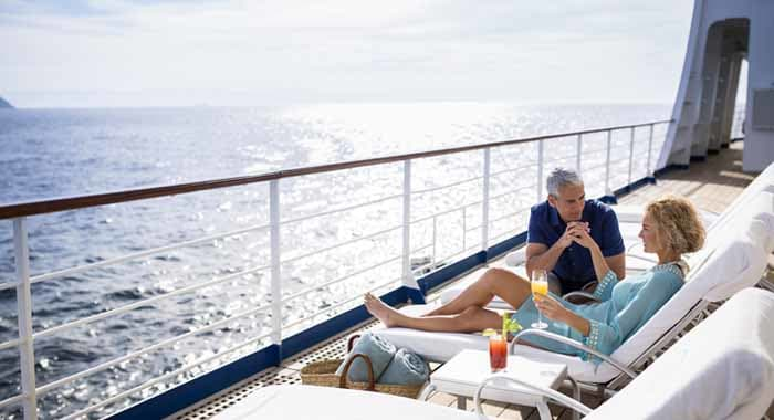 Couple relaxing on Regent Seven Seas deck