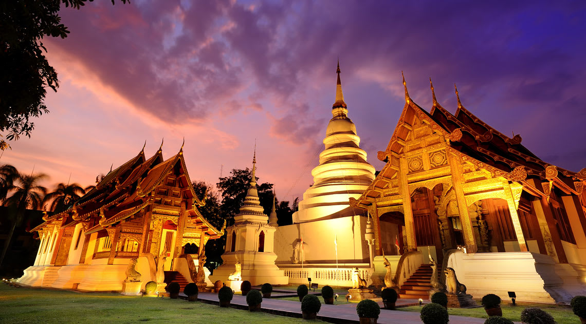Phra Singh Temple at twilight in the western part of the old city centre of Chiang Mai