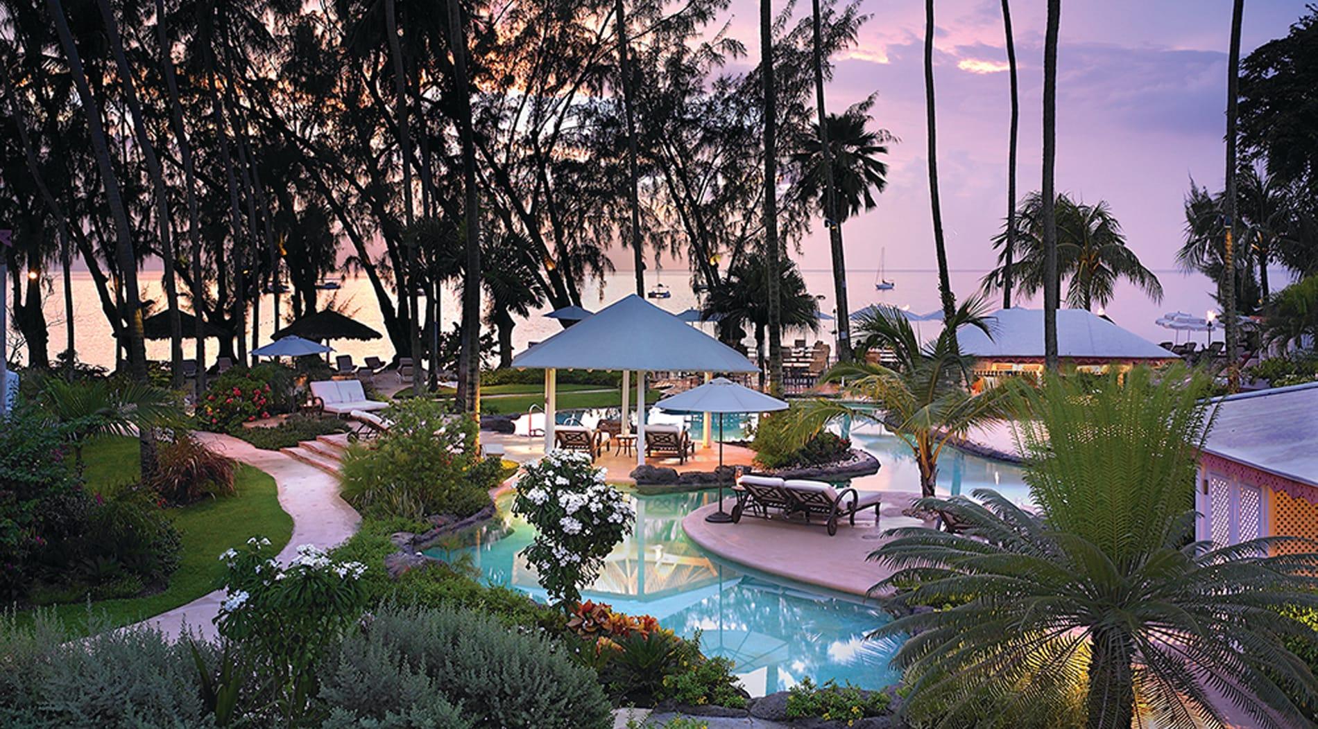 Colony Club gardens, pool, sea and palm trees