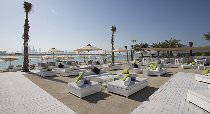 Nasimi Beach Club with white beds on the beach