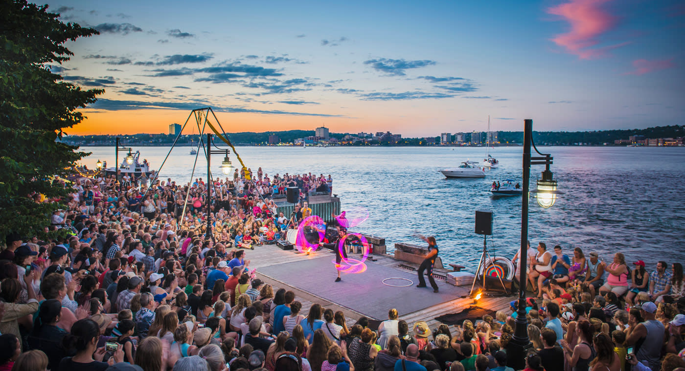Halifax-Waterfront with sunset in the background and a crowd of spectators