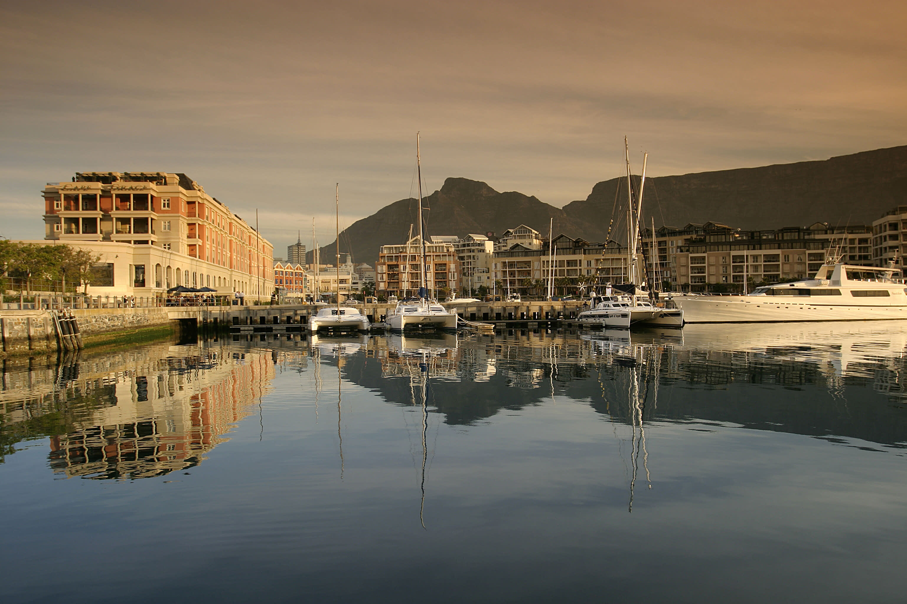 Narina with yachts and buildings in the background surrounded by mountains