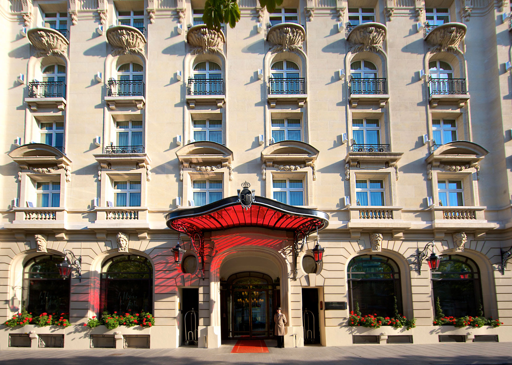 The exterior of the hotel with a doorman at the entrance