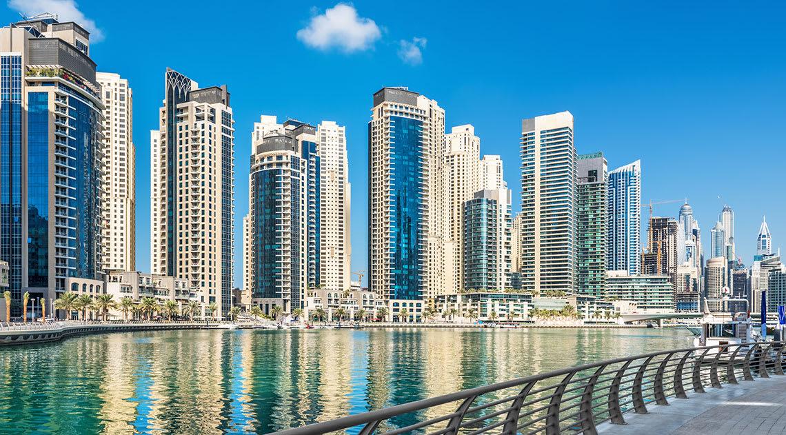 Tall buildings with blue sky and water