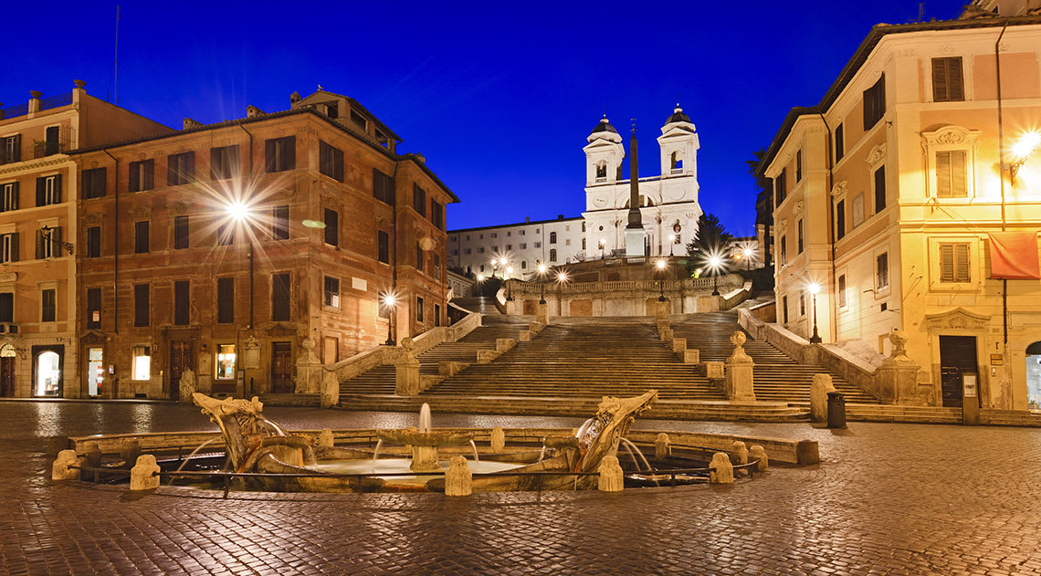 The Spanish Steps at night with the building and steps lit up