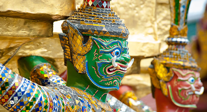 A close up of the face of the emerald Buddha