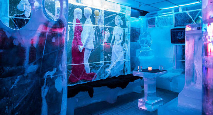 The ice bar with seats and tables made of ice