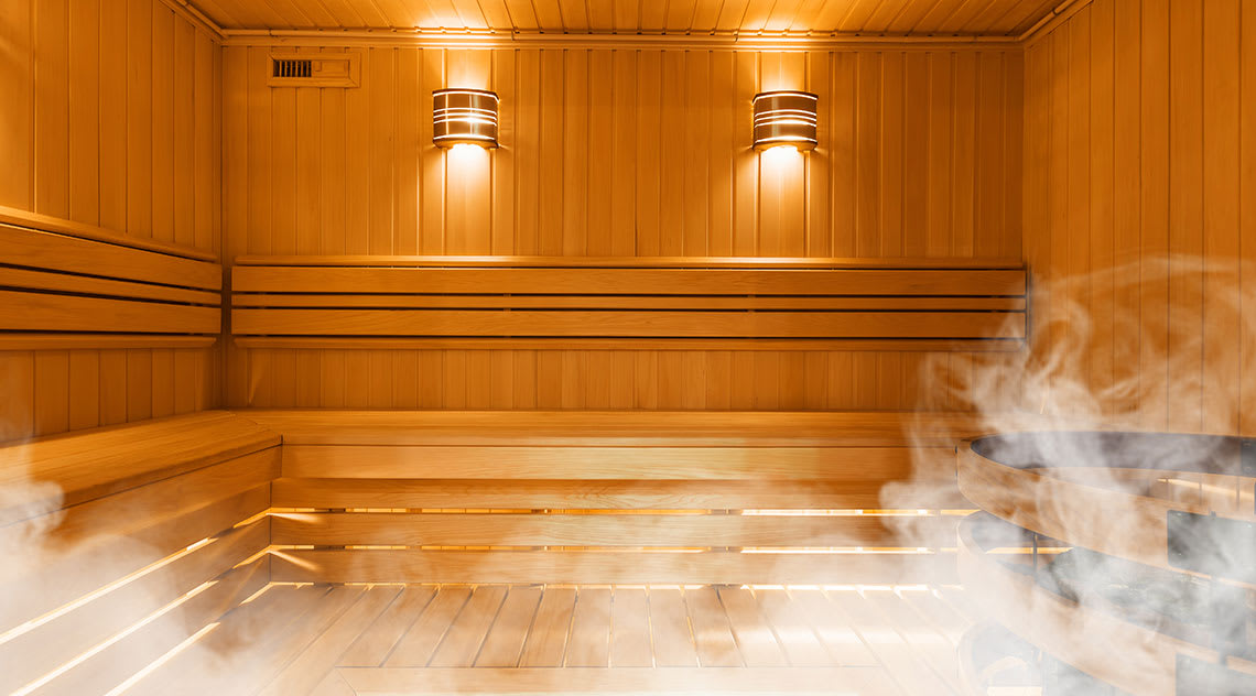 The inside of a sauna with vapour rising
