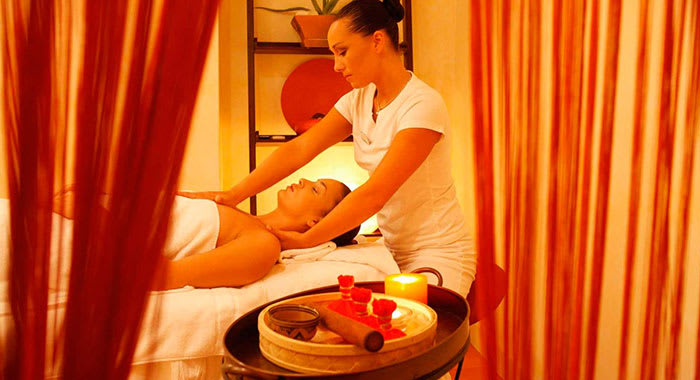 Woman in towel getting a massage at the spa