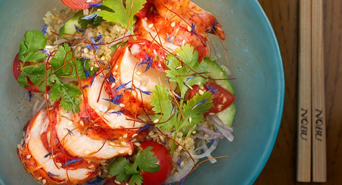 Black cod dish on blue plate