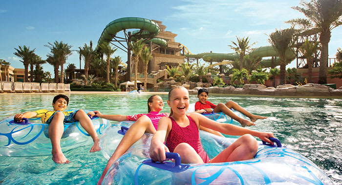 Children on blow up rings in a swimming pool