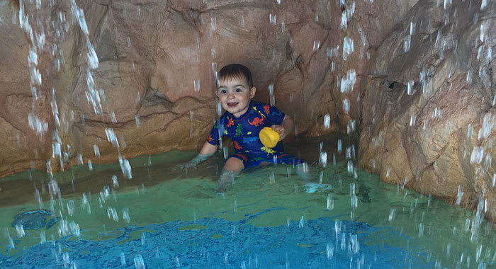 Rocco the toddler in the water feature