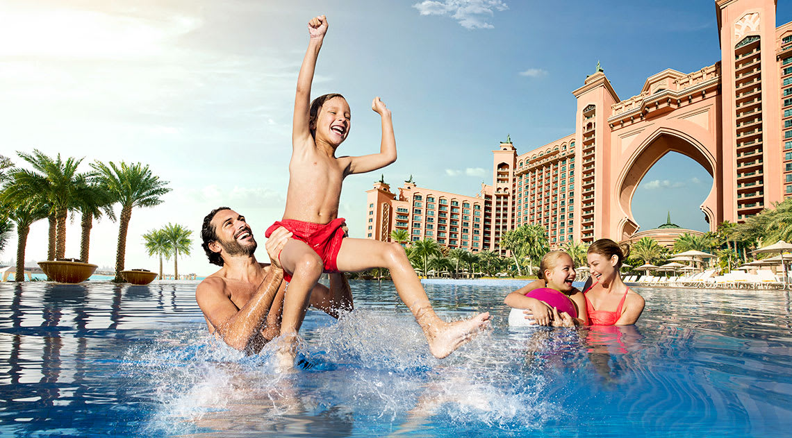 A family having fun in the swimming pool at the hotel in Dubai