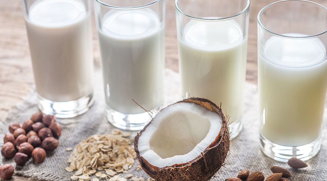 Glasses of milk with nuts and coconut