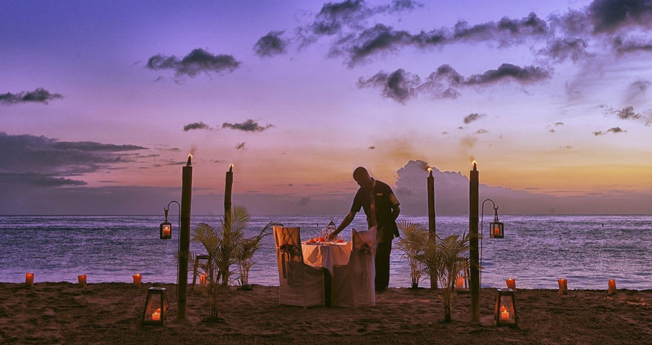 Romantic dining on the beach as the sun sets