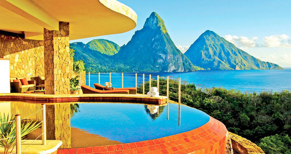 Swimming pool overlooking sea and mountains