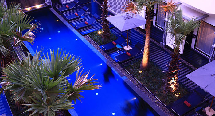 Aerial view of a swimming pool and sun loungers