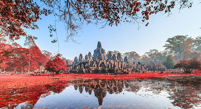 Bayon Castle in Cambodia covered with red leaves