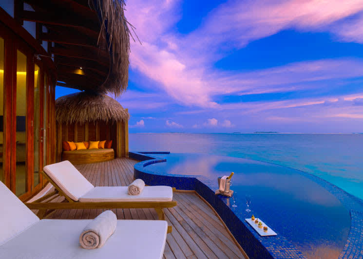 OBLU SELECT at Sangeli   Honeymoon Water Suite with Pool   Deck and Sunset