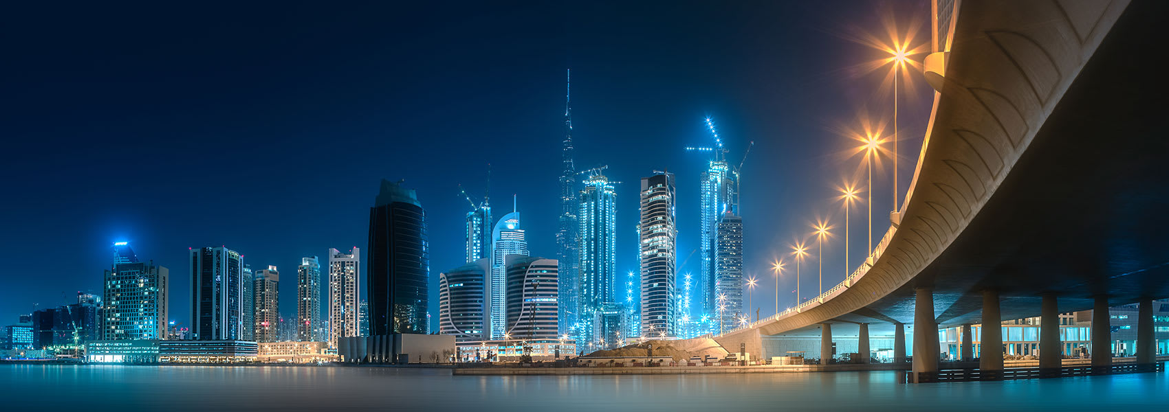 Dubai skyline at night with the city lit up